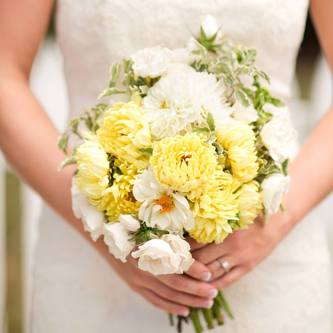 The vibrant bridal bouquet was filled with yellow and white dahlias along with white majolica roses.