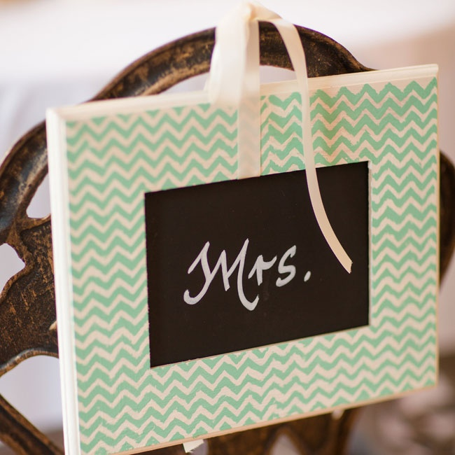 Jenna married two themes of the ceremony and reception, chalkboard paint and a mint chevron pattern, creating colorful Mr. and Mrs. chair signs.