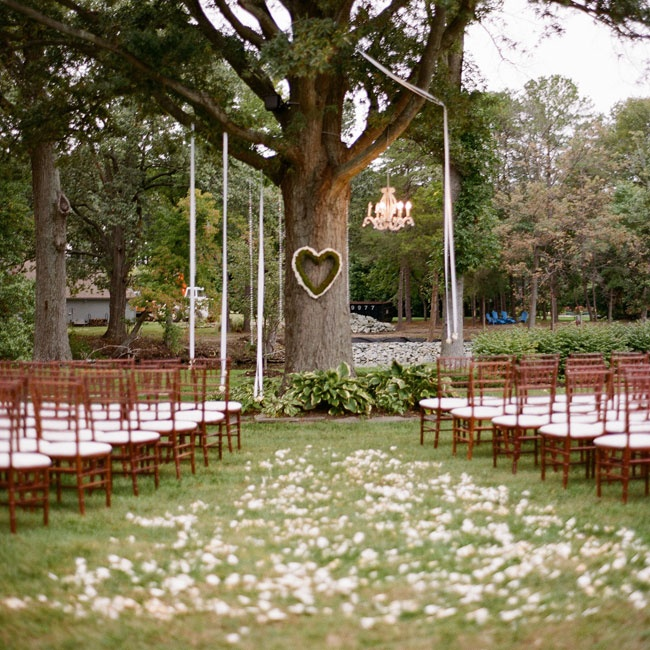Simple Rustic Backyard Wedding :  backyard along with dark chiavari chairs for a lovely rustic outdoor