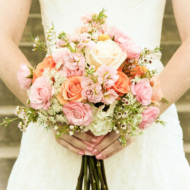Allison carried a bouquet of fresh roses in light pink and orange colors.