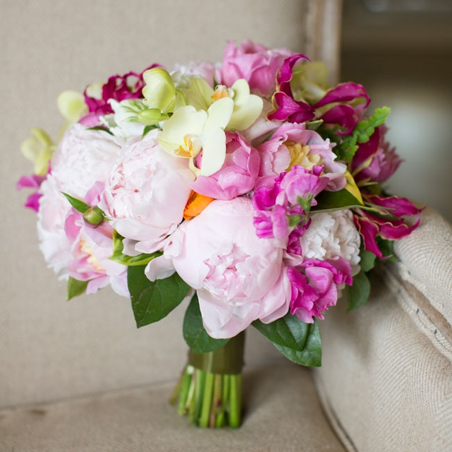 Anne, a professional wedding florist, carried a lush pink peony bouquet with pops of fuchsia freesia.