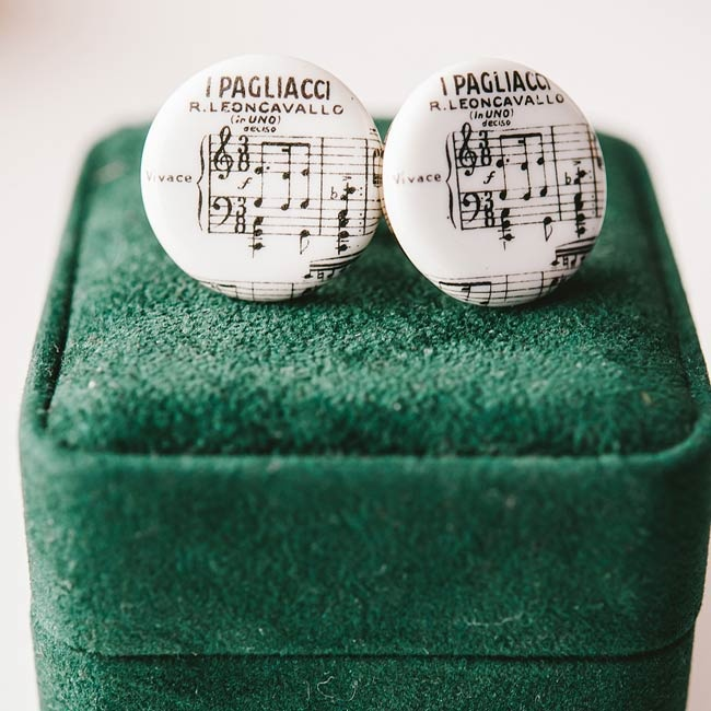 Cameron wore vintage cufflinks with a music score design.