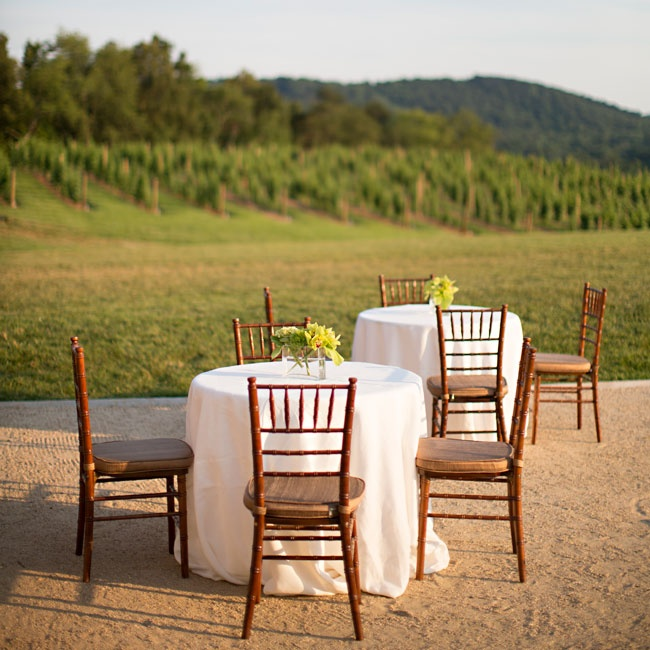 Guests were able to enjoy a gorgeous sunset over the mountains during the outdoor cocktail hour with ivory linens and dark chiavari chairs.