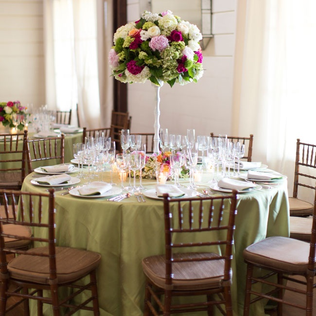 The traditional reception decor included olive green linens, dark chiavari chairs and lush high centerpieces of hydrangea, peonies and roses.