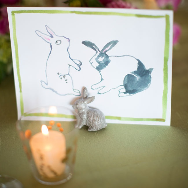 Each table displayed a different creative watercolor personal to the couple (they have pet rabbits!) instead of a traditional table number.