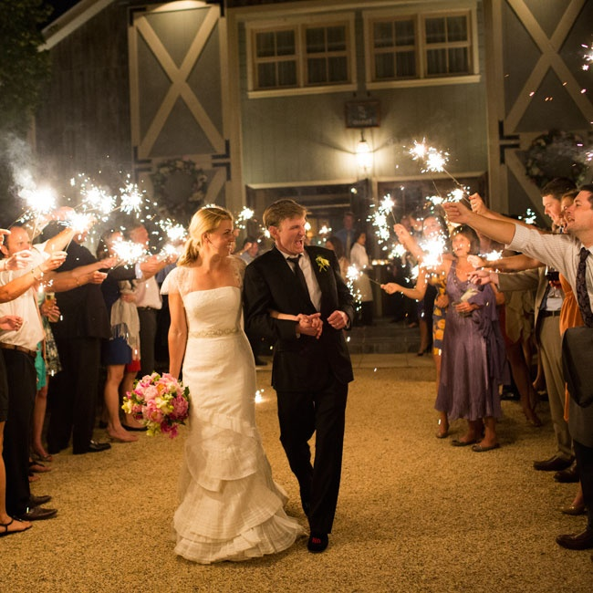 The couple left their reception surrounded by all of their favorite people and festive sparklers!