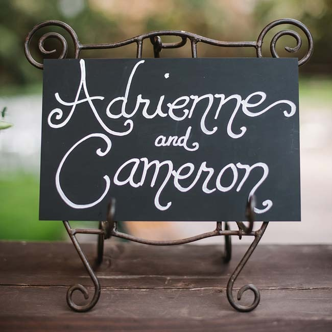 The couple created a black and white, hand-painted sign to welcome guests to the cocktail hour and reception site.
