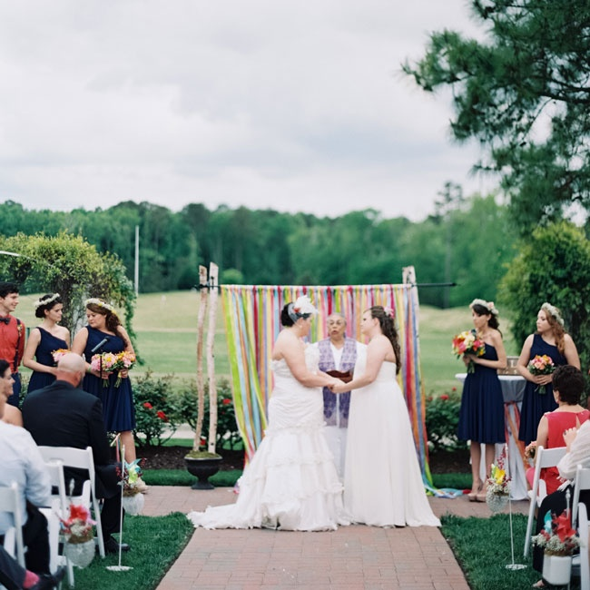 Lizzie and Tracy were both escorted down the aisle at the same time and placed their vows into a a handmade wooden box before securing the lock.