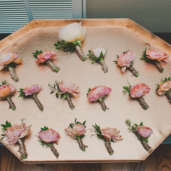 Groomsmen wore pink rose boutonnieres wrapped in twine.