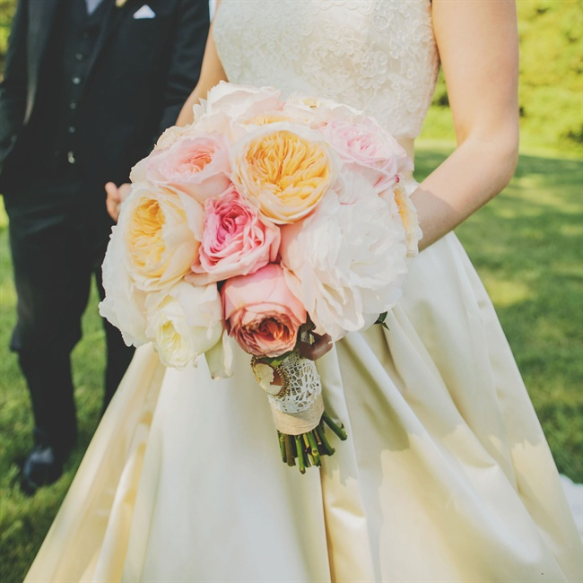 Natalie's rose and peony bouquet was wrapped in lace and secured with an antique cameo silhouette brooch.