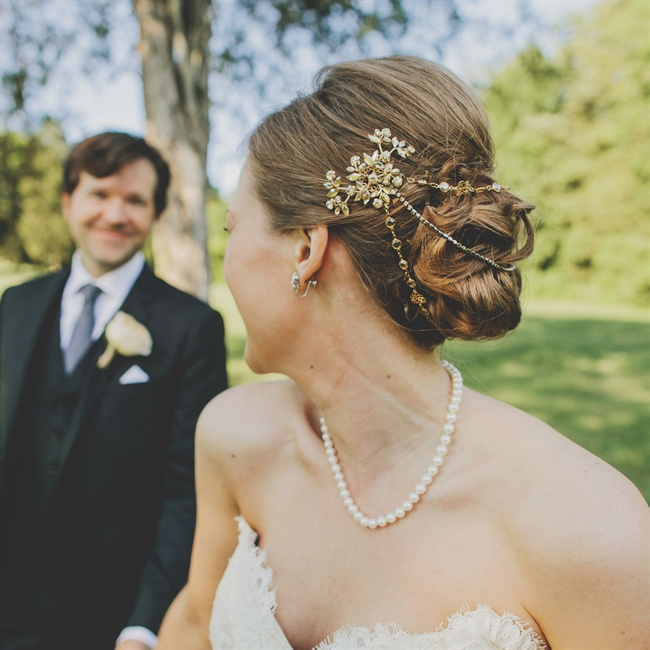 The bride adorned her elegant low updo in a gold, three-strand headpiece with Swarovski crystal embellished combs.