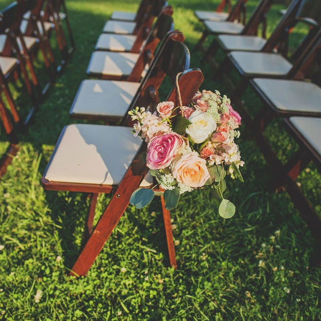 Pink and white roses hung from twine marked the aisles during the ceremony.