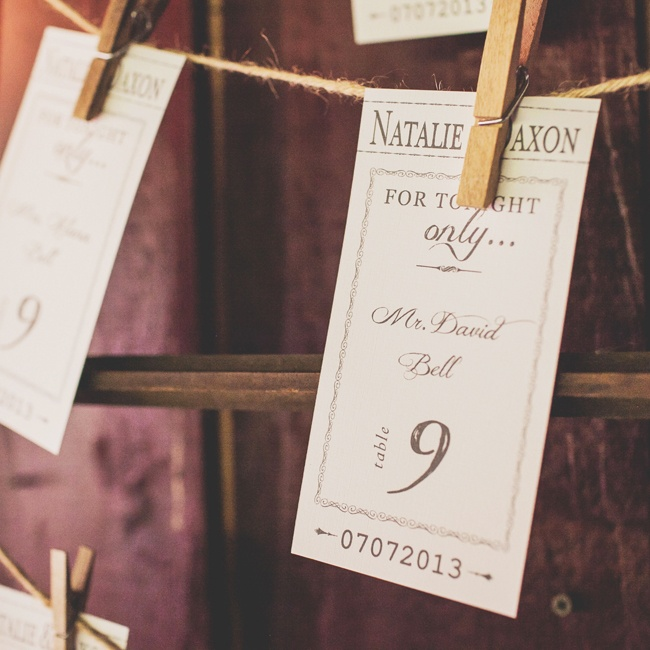 Natalie and Dax's escort cards looked like vintage admit one theater tickets hung up with twine.