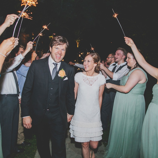 The happy newlyweds rang in the end of the night beneath lit sparklers.