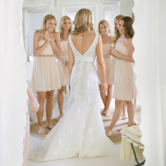 The bride and the bridesmaids wore their hair down and parted to the side for the ceremony and reception.