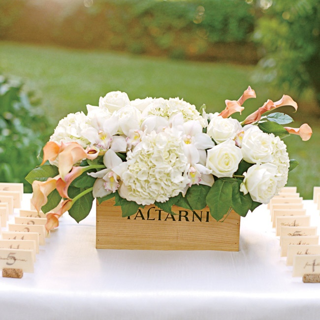 The escort cards were written by a local Hawaiian woman in dark brown ink and placed in slotted wine corks to keep in theme with the French vineyard style of the wedding.