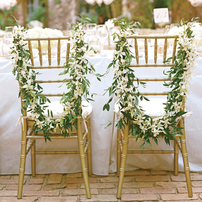 Fresh green and white garlands distinguished the bride and groom's chairs from the rest of the head table.