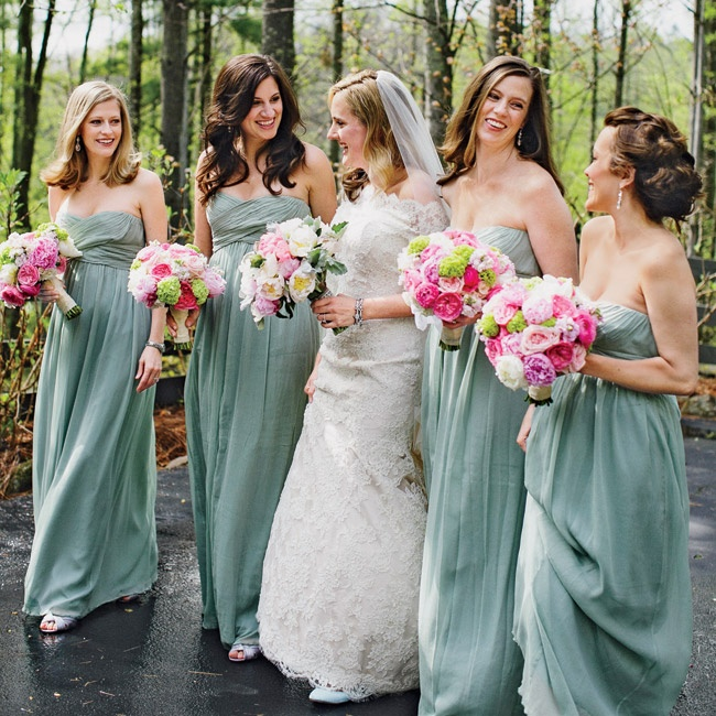 The bridesmaids wore light sage dresses from J. Crew with custom earrings from Diana Warner. The bride also gifted her attendants with light pink pashminas and sparkly flip-flops for the reception.