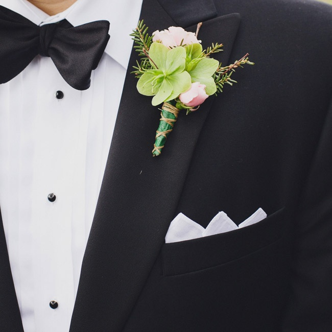 The green and pink boutonnieres were filled with pine sprigs and cabbage roses to honor the bride's beloved grandfather.