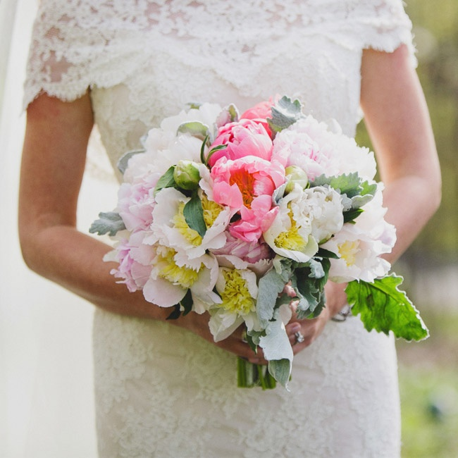 Lanier's bridal bouquet was filled with peonies, cabbage roses and lamb's ear.