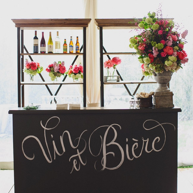 """Wine and beer"" written in French calligraphy signified one of two chalkboard bars at the reception."