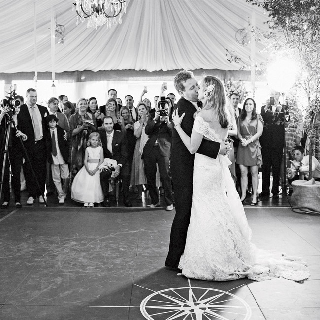 The couple shared their first dance as newlyweds on their chalkboard paint dance floor, on top of a painted compass motif.