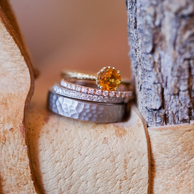 Anja paired her unique yellow sapphire gem engagement ring with two wedding bands -- one in white gold and the other in rose gold. Ben's band is hammered palladium.