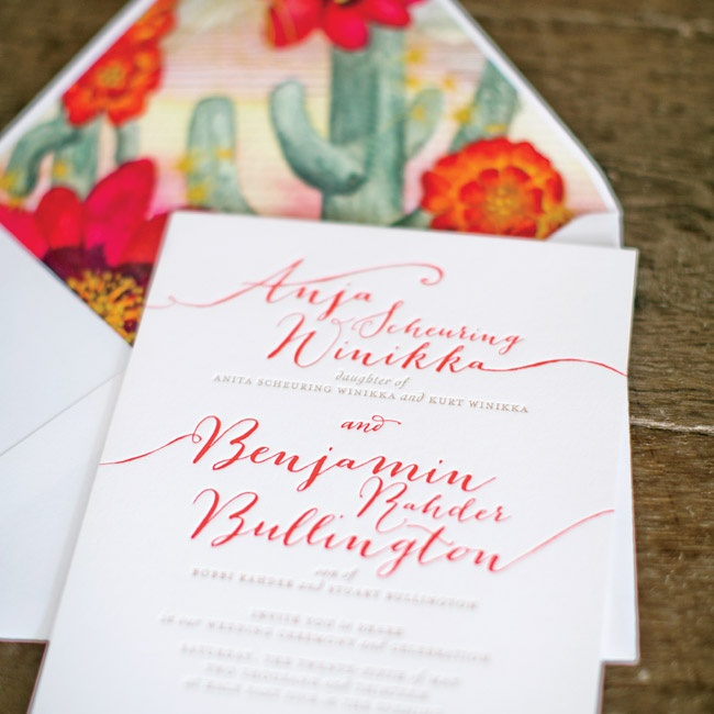 The couple's letterpressed invitation suite was paired with a custom watercolor envelope liner -- painted by Ceci New York -- inspired by the Arizona desert setting.