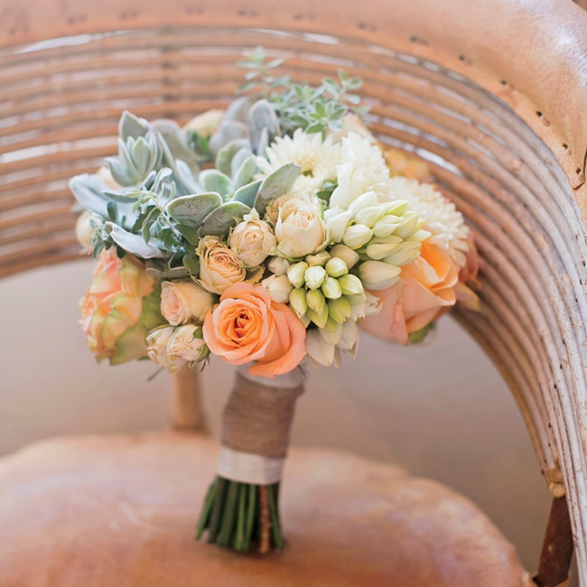 The bridesmaids carried rustic bouquets made of succulents and peach and ivory roses. The stems were tied together with twine.