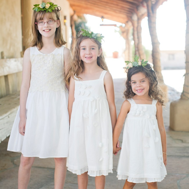 Anja's three flower girls wore white cotton dresses, gold flats and little fresh flower crowns. As they walked down the aisle, they held little galvanized buckets full of petals!