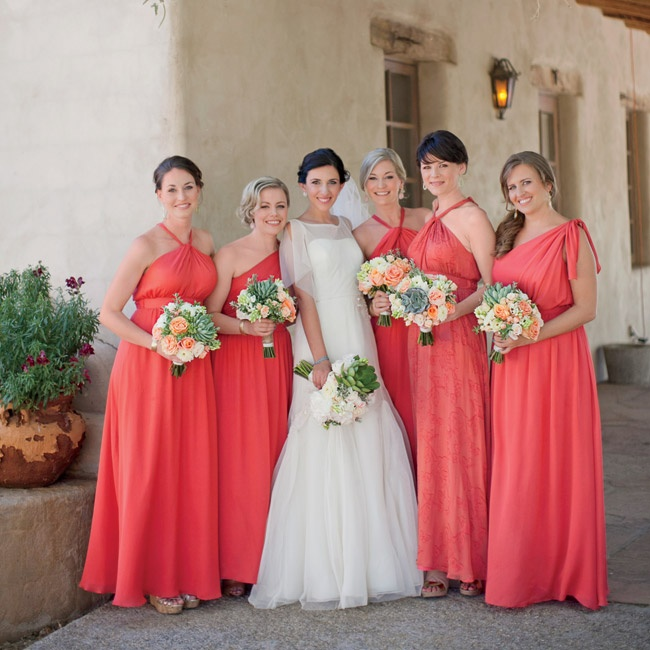 Anja's five bridesmaids wore similar dresses with different necklines. Her maid of honor stood out in a dress made in the same color but with a tone-on-tone pattern. To accessorize, each bridesmaid wore simple drop earrings in light pink and turquoise.