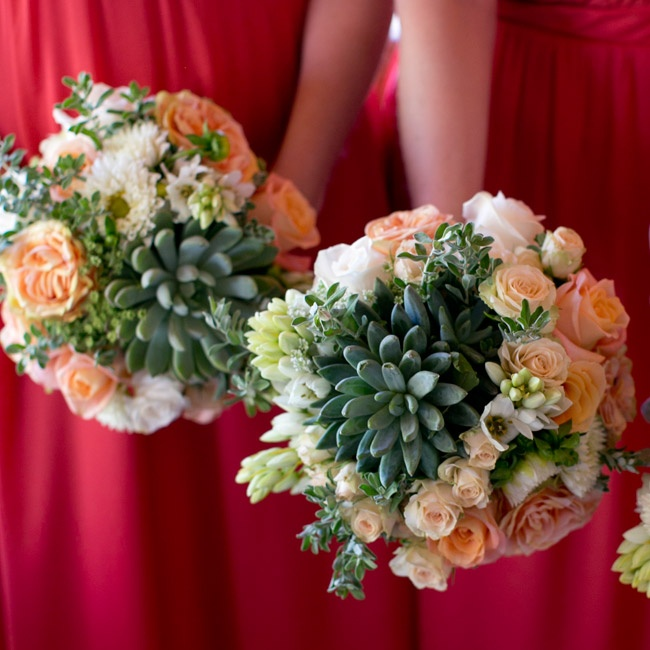 The soft peach bridesmaid bouquets complemented their bright coral dresses and prominently featured succulents.