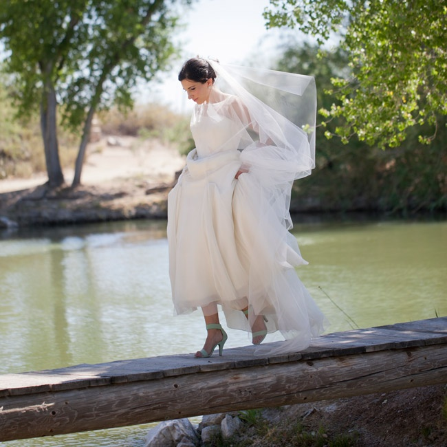 The bride's turquoise suede shoes fit in perfectly with the southwestern scenery of her venue. Tanque Verde Ranch is set against the Rincon Mountains and the Saguaro National Forest, and the property varies from cacti to cottonwood trees.