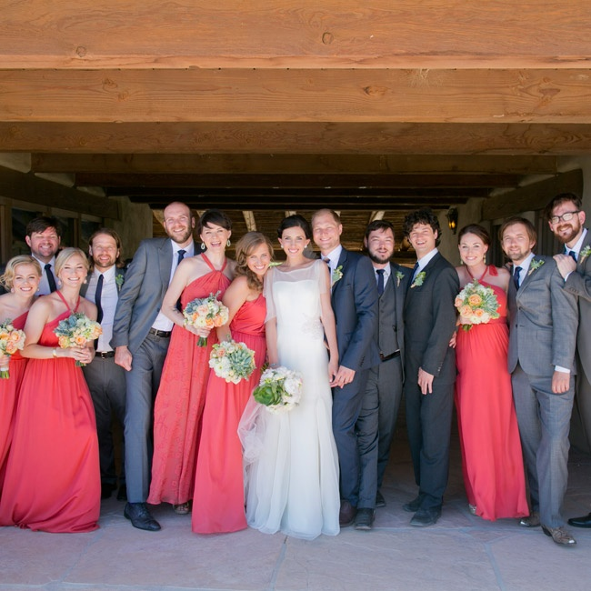 The groomsmen wore their own gray suits and wore matching skinny navy ties and brown shoes. Ben stood out from the rest in a a navy suit from Top Man.