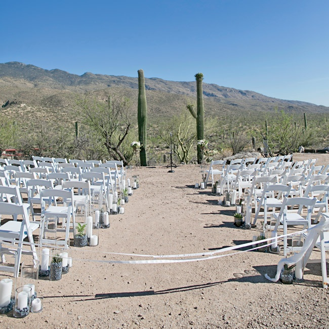 "The ceremony took place in the desert up near the Rincon Mountains just before sunset. ""We wanted to get married in the dirt surrounded by the desert,"" Anja says. They exchanged their vows between two cacti in the shadow of the Rincon Mountains."