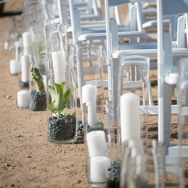 Tall vases filled with succulents, small cacti and candles lined the ceremony aisle.