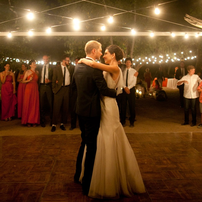 "Anja and Ben's first dance was a classic -- Otis Redding's ""That's How Strong My Love Is."" The outdoor open-air dance floor had been created by hand out of four giant saguaro cactus ribs and string lights."
