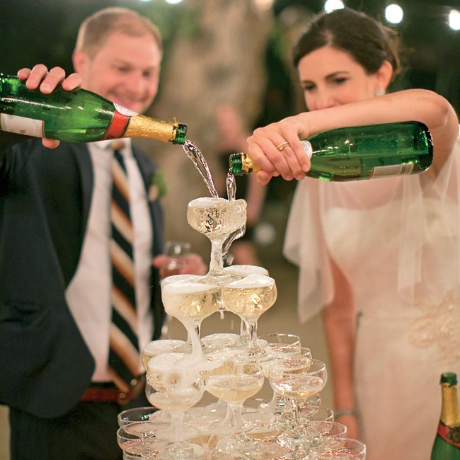 "A champagne toast was a festive way to end the evening -- especially because the couple dramatically poured the bubbly into a tower of vintage coupe glasses. ""The idea was to celebrate classic wedding elements,"" Anja explains."