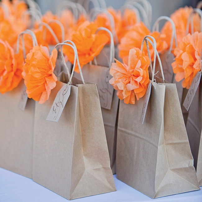 Just as guests arrived from all across the country, they received these simple welcome bags tied off with bright orange paper flowers and a custom monogrammed stamped tags. The bags were filled with local Arizona favorites like prickly pear candy, chocolate covered espresso beans and orange slices.