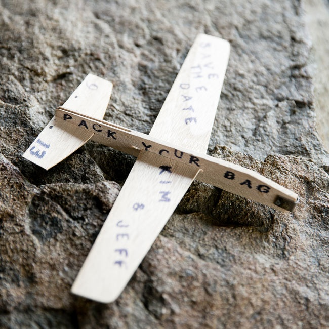 Since the groom is in the U.S. Air Force, the couple decided to use small airplanes as their save-the-dates.