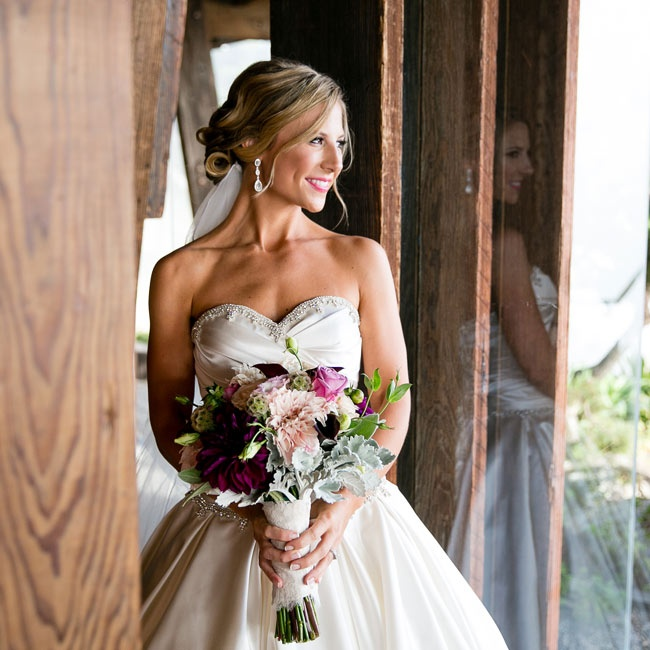 The bride wore a voluminous gown with a sweetheart neckline and beaded detailing from Pnina Tornai.