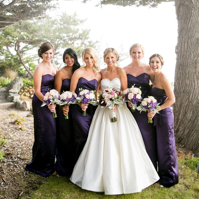 Kim's five bridesmaids wore dark purple formal-length gowns with matching bouquets of dahlias.
