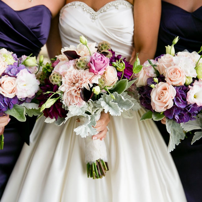 Light pink roses paired with dark amethyst hydrangeas filled the bridesmaids' bouquets.