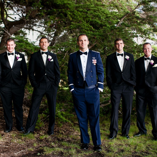 Jeff's groomsmen wore traditional black tuxedos with matching black bow-ties.