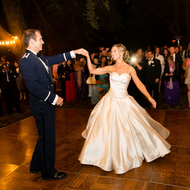 The couple shared their first dance outside on a wooden dance floor.