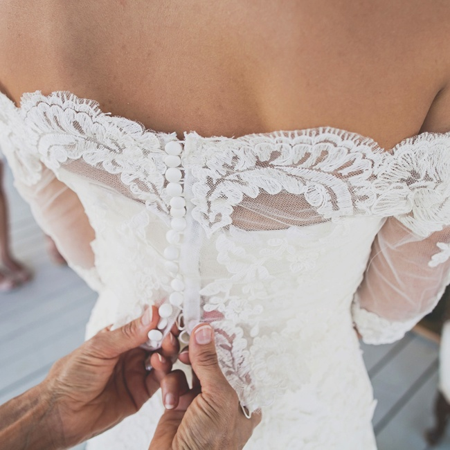 Brooke's off-the-shoulder, scalloped lace gown had delicate buttons down the back.
