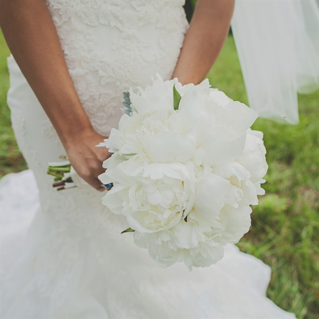 The bride carried a traditional white peony bouquet.