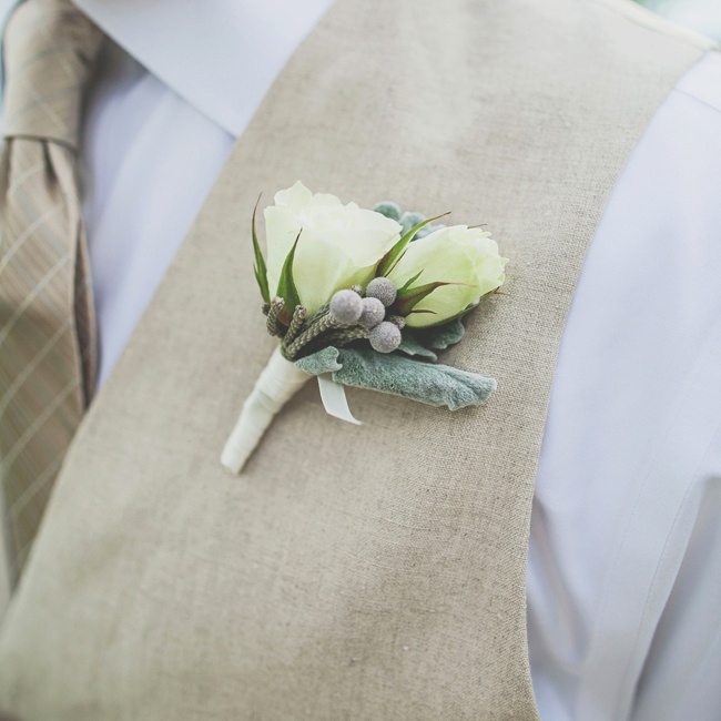 The groomsmen's boutonnieres featured lamb's ear and white roses.
