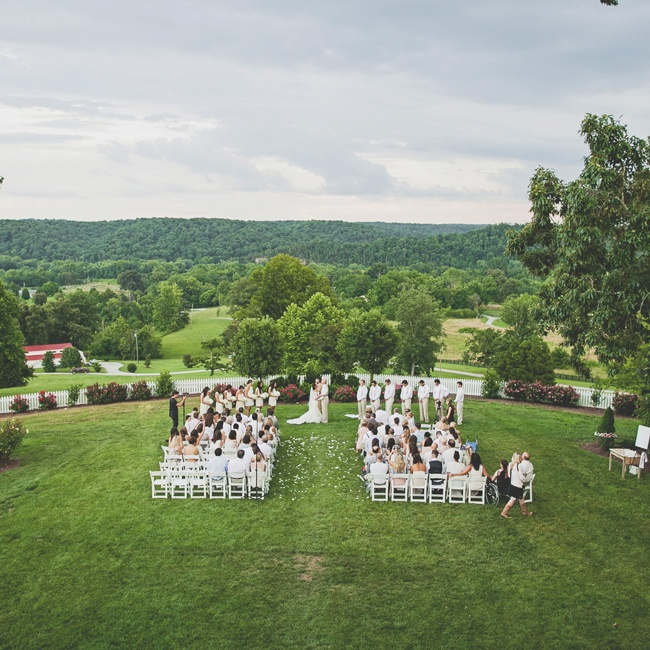 Brooke and Matt had a traditional ceremony outside in a garden with white wooden folding chairs.