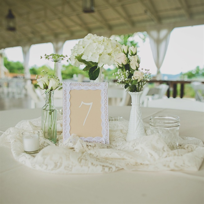 The reception decor was simple and elegant with tan table names painted in ivory, surrounded by white hydrangeas and roses and candles.